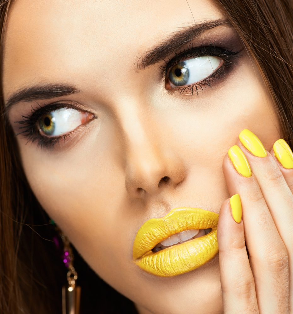 Girl Wearing Yellow Nails