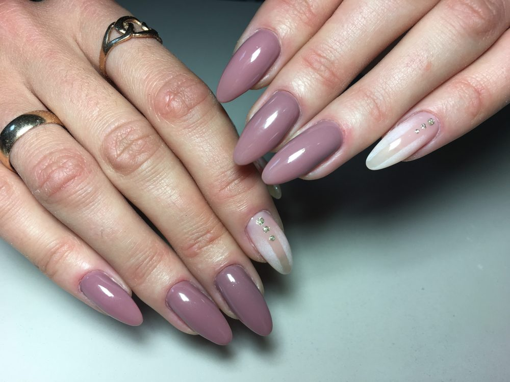 fashionable beige almond manicure