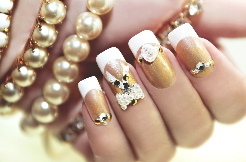 Square acrylic nails, natural, gilded and decorated